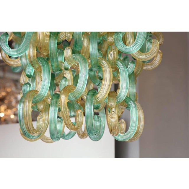 "Murano glass green and gold ""C"" link chandelier."