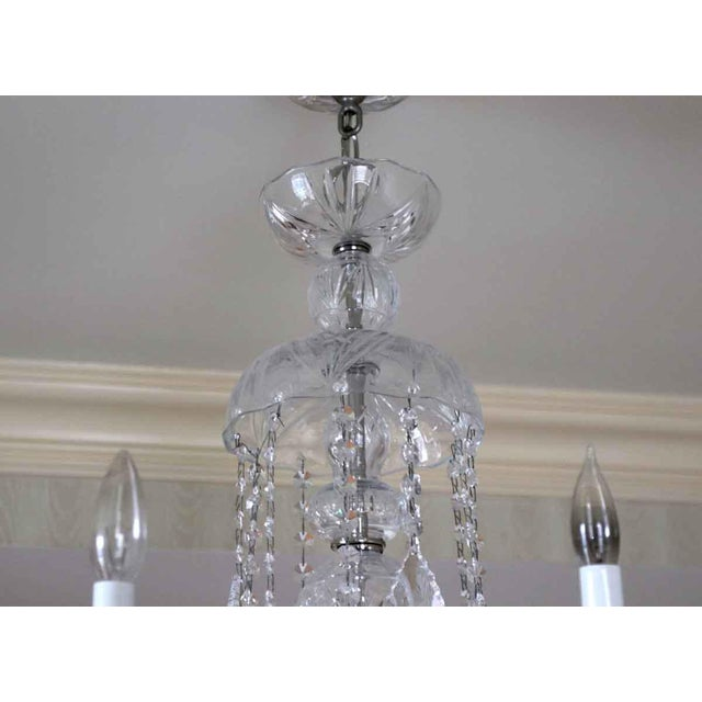 Late century six arm crystal chandelier with nickel and etched glass fittings. These lights adorned the corridors of the...