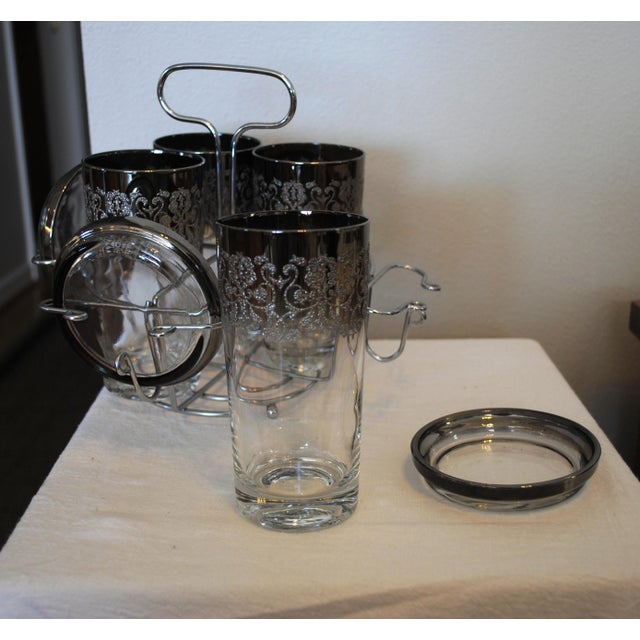 """Vintage Kimiko Cocktail Set. 4 - 8oz. High Ball Glasses, 4 - 3.75"""" coasters and a silver/chrome caddy. The glasses have an..."""