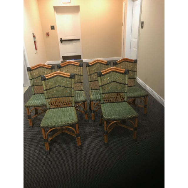 A stunning set of 6 Grange rattan side chairs from the 1970s having an inviting color combination of natural honey colored...