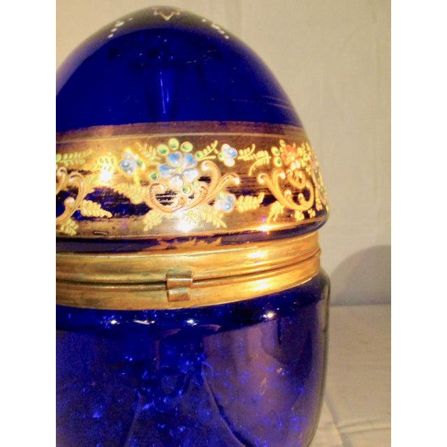 Cobalt blue venetian glass egg holding delicate set of carafe and glasses for very precious liquor . Center piece design...
