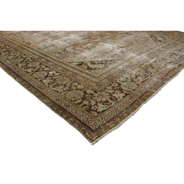 This distressed antique Persian Mahal rug features a modern Industrial style. Highlighting a traditional, yet elegant...