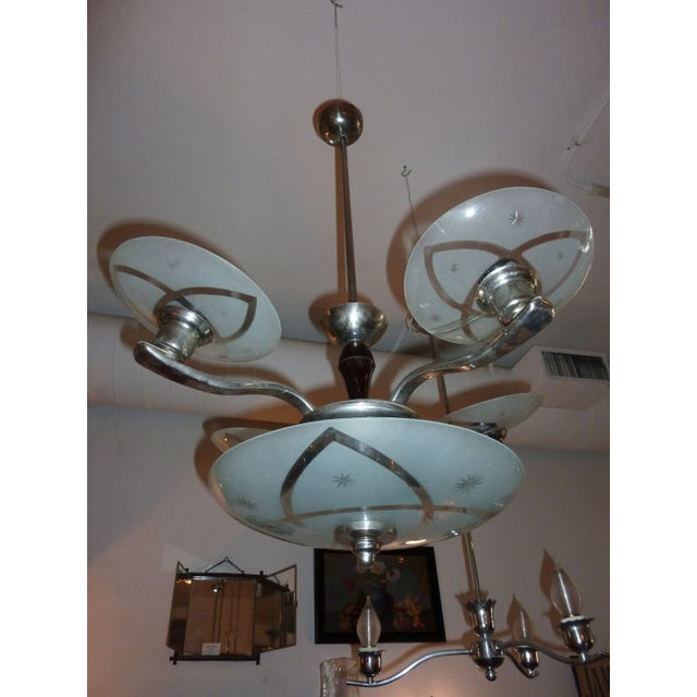 Circa 1930s, this fun chandelier features five crystal glass shades. Each shade is etched glass and nickel base. In...