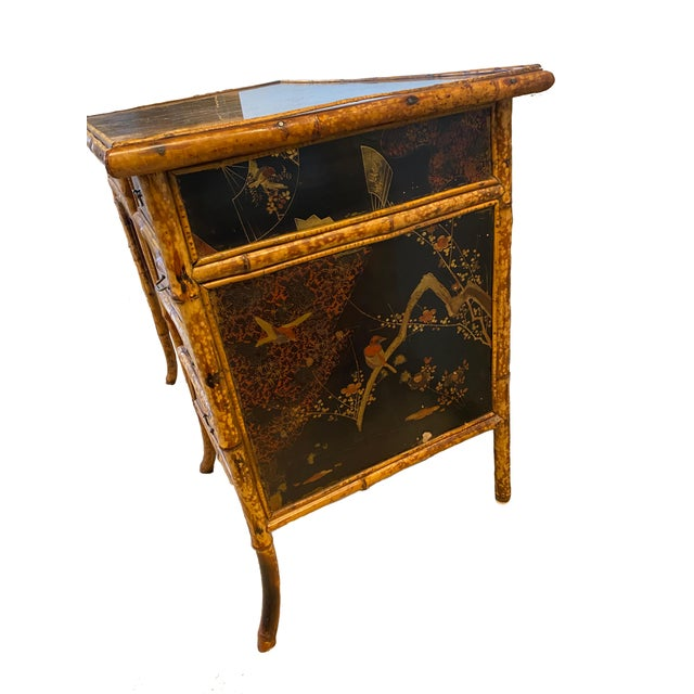 Vintage burnt bamboo desk and chair; American made with Asian (Chinoiserie) inspired detail on two sides; brass drawer...