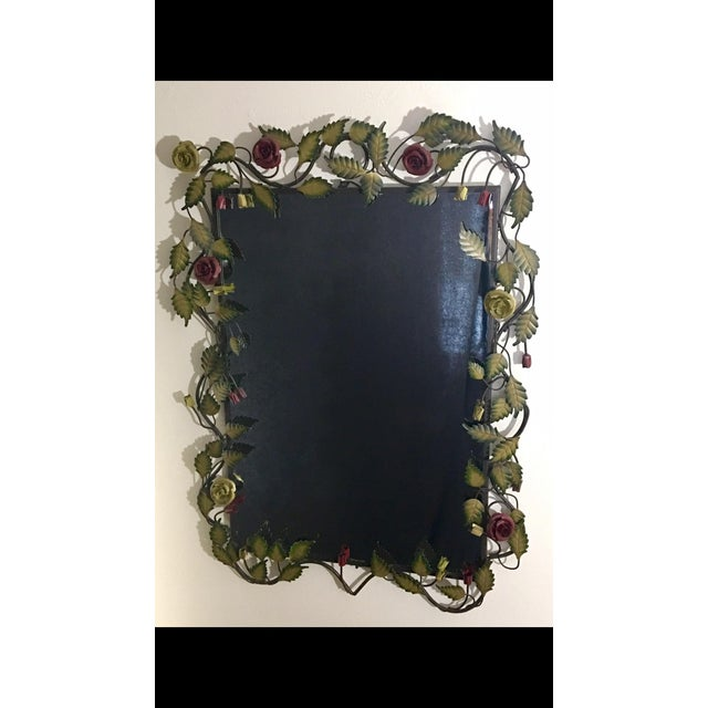 Vintage Z Gallerie mirror with rose and vine decorated metal surround. The surround features oil rubbed bronze framing,...