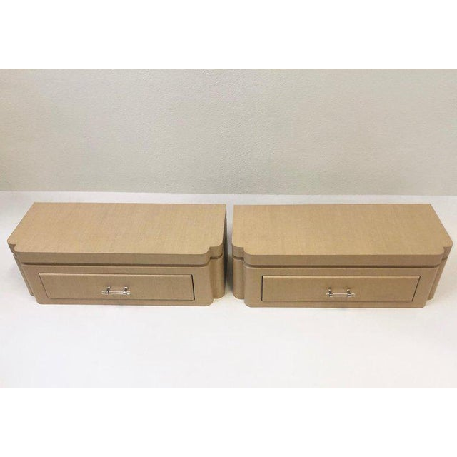 A beautiful pair of floating nightstands design by Steve Chase in the 1980s. The nightstands are wrapped in natural...
