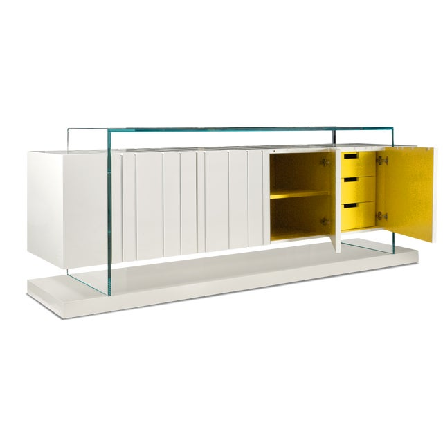 A beautiful and functional double-sided cabinet with Glass top and Wooden Base painted white high gloss and internally...