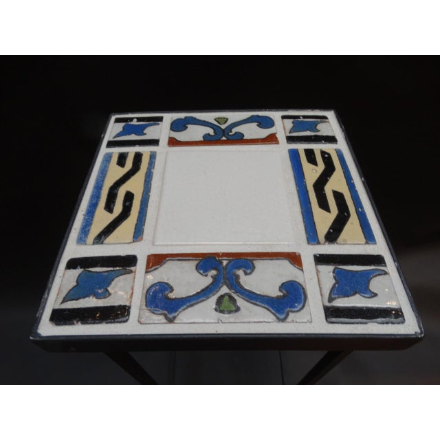 Malibu tile Spanish revival cocktail table or drink stand. Made with original Malibu tiles, 8 of them surrounding a center...