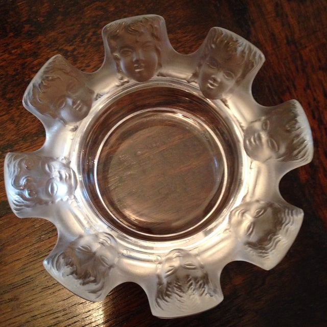 This ashtray/ trinket dish featuring 8 frosted angels. Originally designed by Marc Lalique in 1954. Stamped and signed.