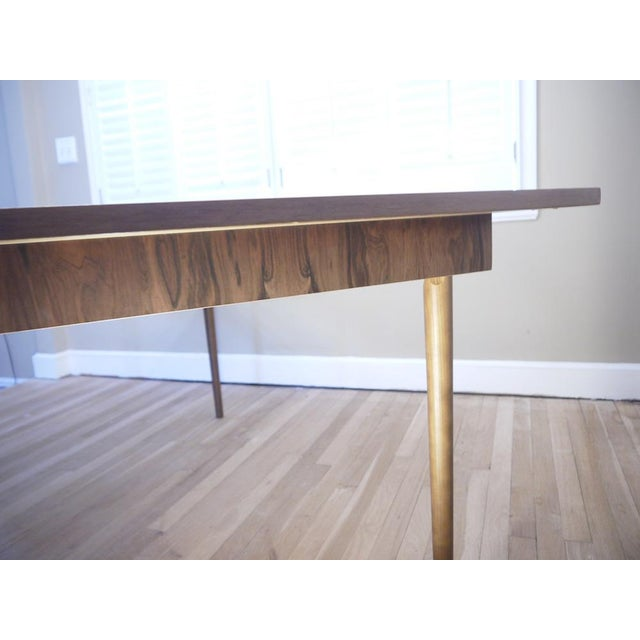 This is a beautiful Mid-Century dining table with leaf. It is made of solid wood, I believe it to be Walnut based on...