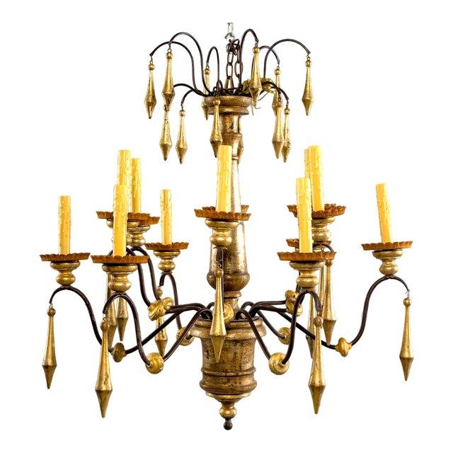 Large Italian Twelve Light Gilt Wood Chandelier For Sale