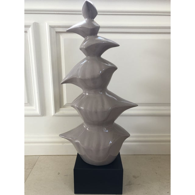 This 30 inch tall mid century piece appears to be abstract, minimalist ceramic birds stacked upon a black composite...