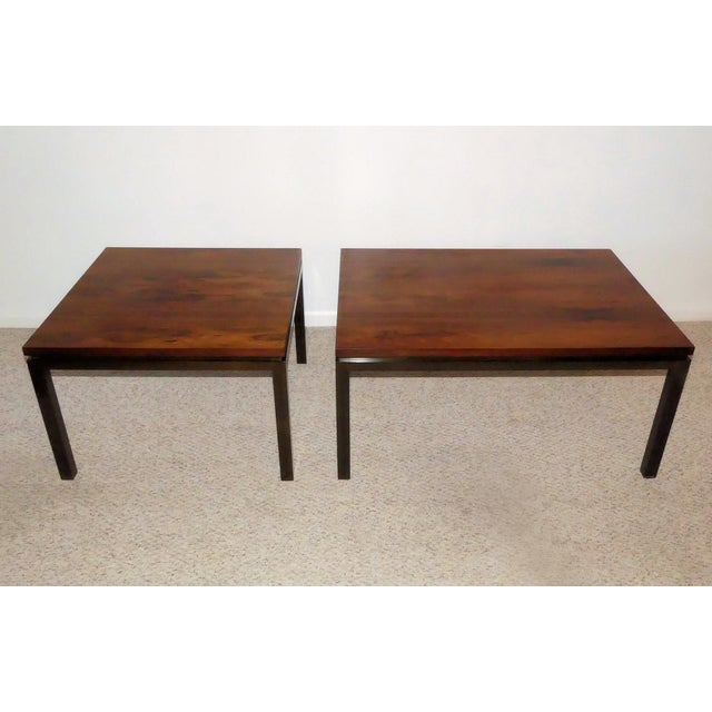 A Pair of Mid-Century Modern cocktail tables designed by Harvey Probber. This matched pair, featuring a square and...