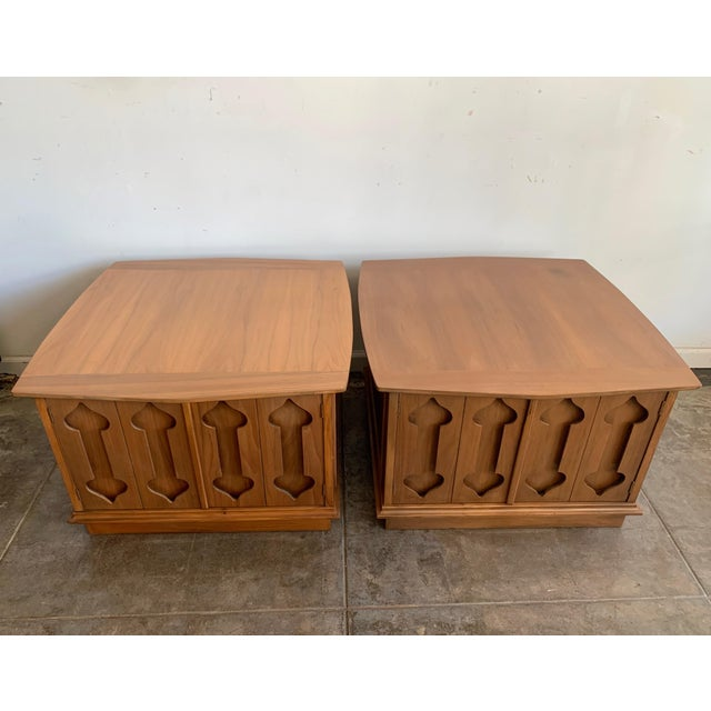 """Mid-Century Modern low walnut Credenza cabinet carved """"Spade"""" front with side molding.. Sleek sculptural form, circa..."""