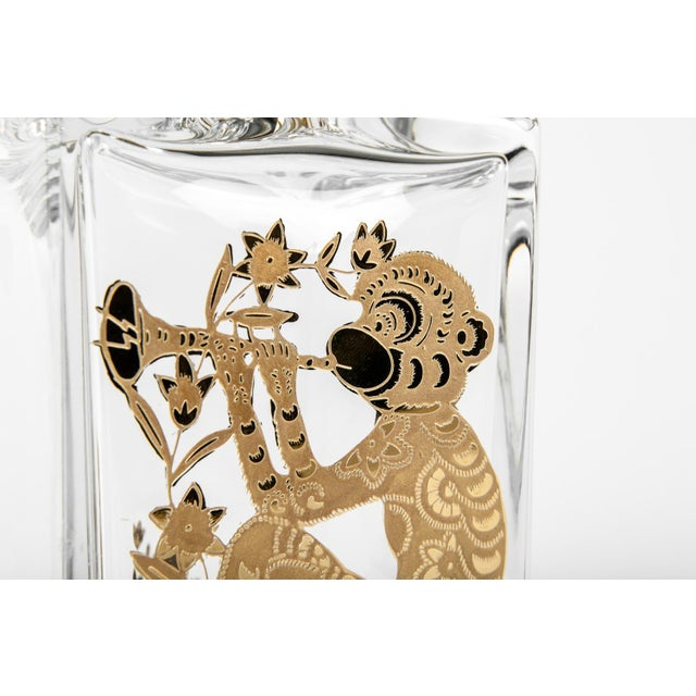 """European crystal decanter with gold monkey design. The decanter measures 9"""" High X 4"""" Width."""