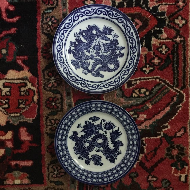 Set of 2 Blue and White Asian Dragon Plates Made by Bombay China Can be used to eat off of, or hung on your wall! Each...