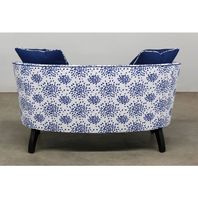 Custom made settee. Includes pillows upholstered in blue and white pattern fabric.