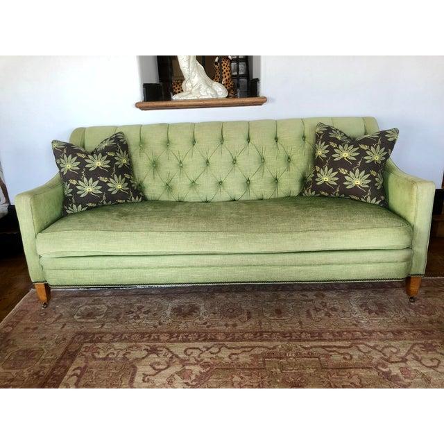Green chenille tufted sofa.