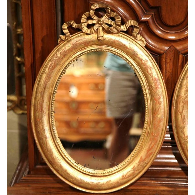 Late 19th Century 18th Century French Louis XVI Oval Gilt Ribbon Bow Mirrors - a Pair For Sale - Image 5 of 9