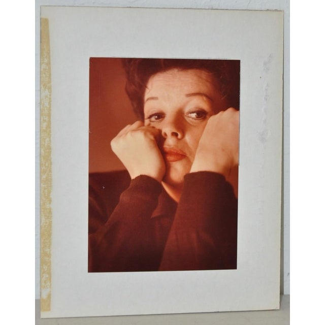 Beautiful color photograph of American actress Judy Garland. Shown here in a relaxed, and thoughtful mood. The photograph...