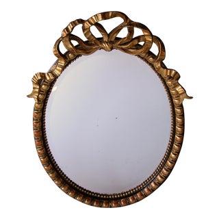 Large-Scaled Napoleon III Ebonized and Giltwood Oval Mirror For Sale
