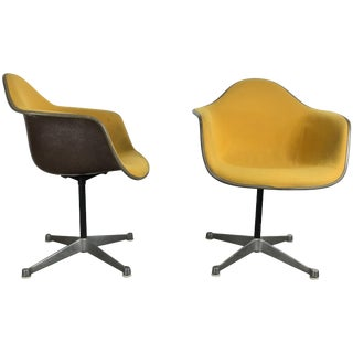 Charles and Ray Eames Swivel Padded Arm Shell Two-Tone Chairs - A Pair For Sale