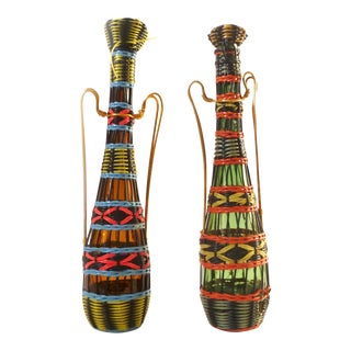 Vintage 1960s French Scoubidou Woven Plastic Wicker Lanyard Wrapped Vessel Wine Bottles - a Pair For Sale