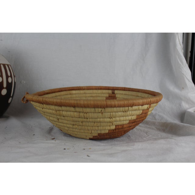 Handwoven African tribal basket in unique triangular pattner with varying shades of brown and tan. Made in the mid 20th...