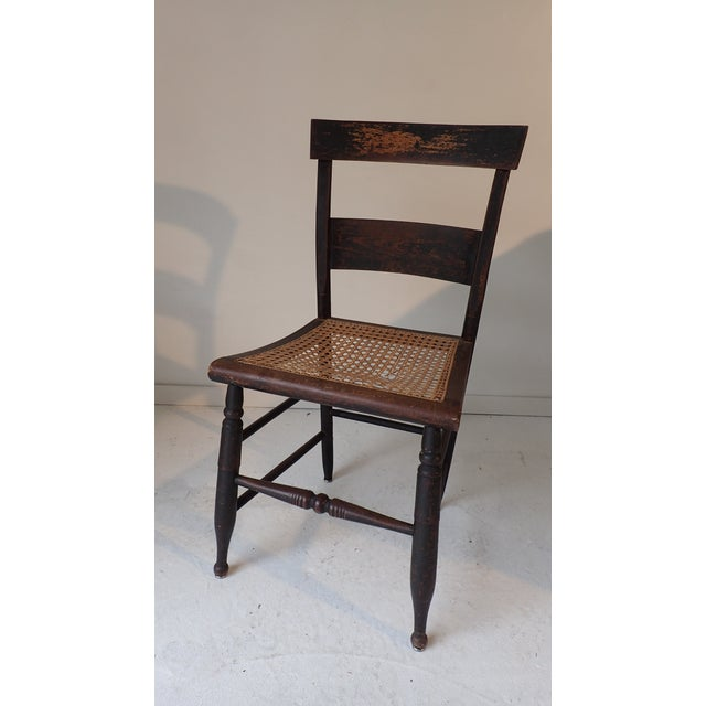 Antique Caned Country Chair. Caning should be replaced, presently indented and torn. No maker's mark Heavy wear through...