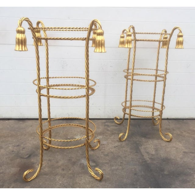 This listing is for a pair of metal Hollywood Regency style gold gilt pair of stands. Glass isn't included. Condition-...