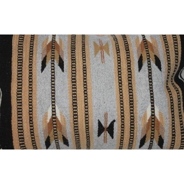 Geometric Navajo Indian weaving bolster pillow with a cotton tan linen backing. The condition is very good.