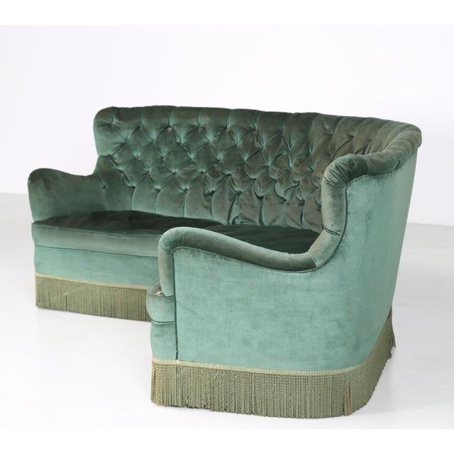 Borsani sofa abvaredo production of the 40s made of green velvet. The fabric is original of the time. On the edge of the...