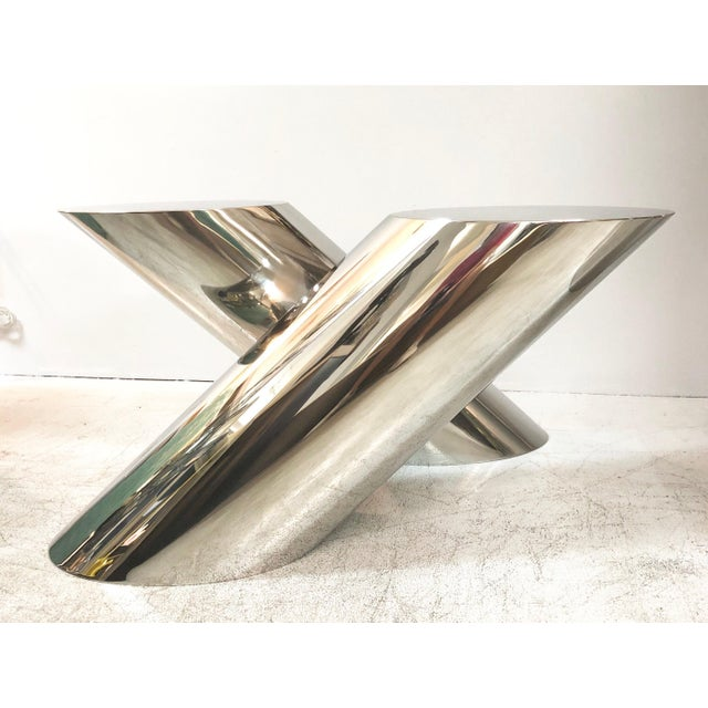 The Zephyr table by Brueton. Designed by J. Wade Beam, this table has become a classic due to its uncanny ability to evoke...