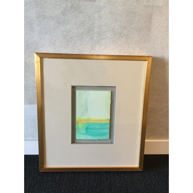 Soicher Marin Block watercolor print in teal tones from Soicher Marin's 'Contemplative Spaces' series. Set in a gold frame...