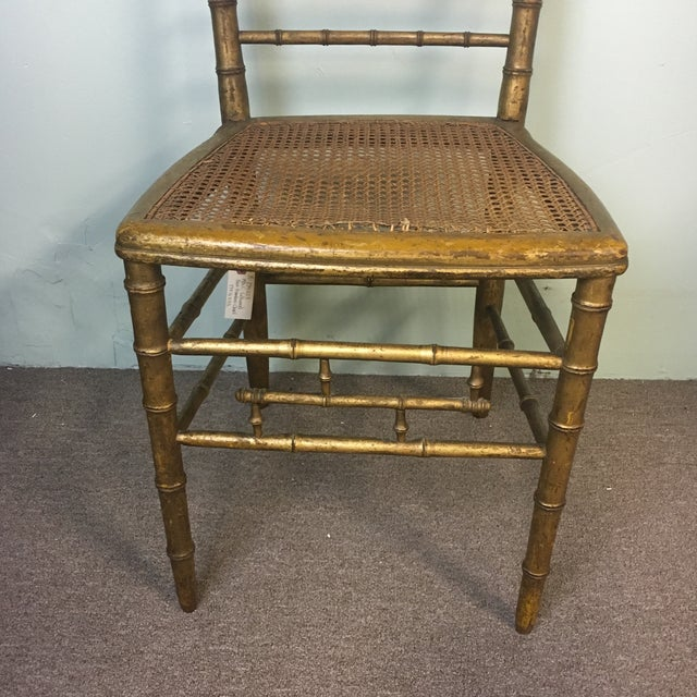 19th Century Giltwood Faux bamboo side chair. Cane seat is broken on the front edge as seen in the picture.