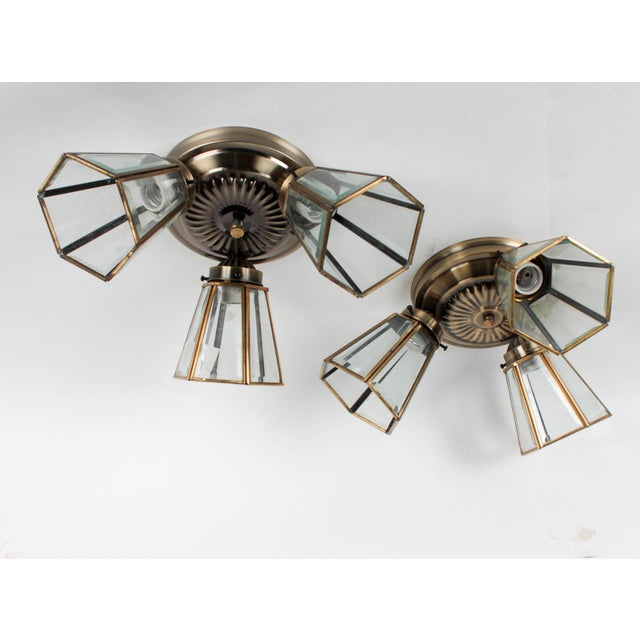 Pair of 3-Lamp Brass Ceiling Fixtures with Glass Shades Fixture has been previously installed and shows signs of use....