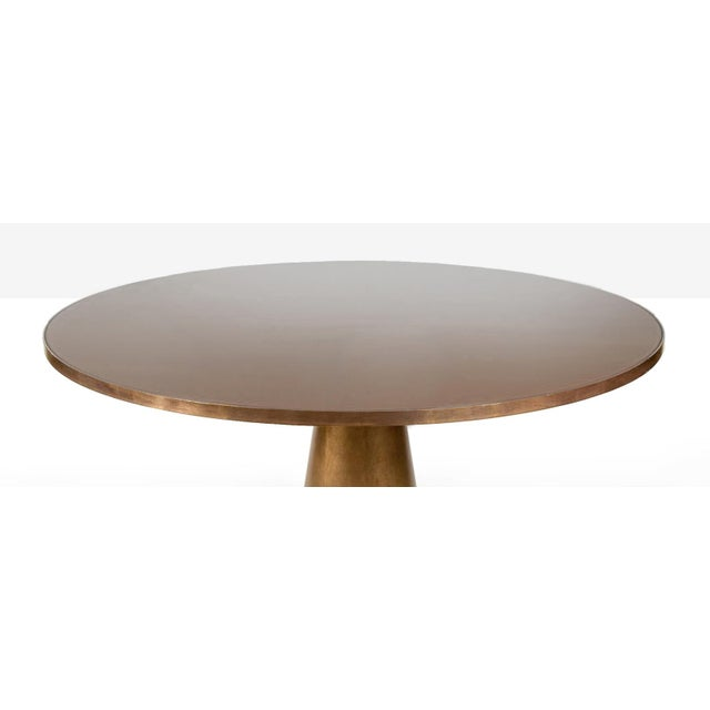The Brooks Dining Table is constructed of solid steel. The body is brass-brush plated, a chemical free brassing process....