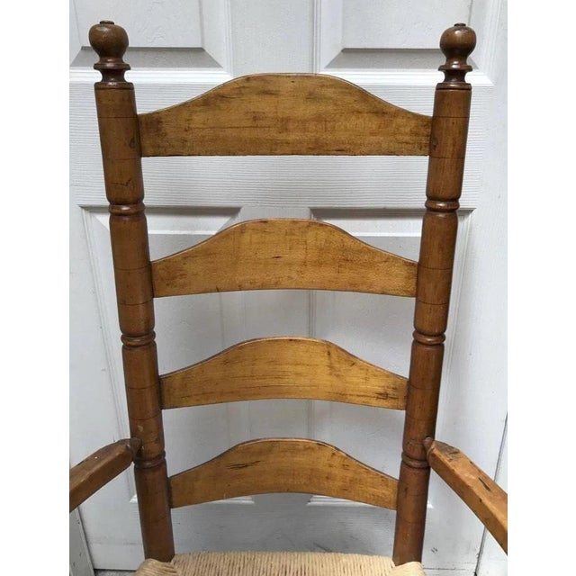 New England four ladder back maple chair. Ring and ball turned stretchers. Traces of old green paint on bottom. Rockers...