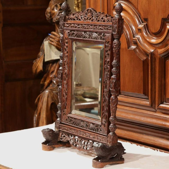 Decorate your vanity or bathroom with this beautifully carved, antique adjustable makeup mirror frame from the French Alps...