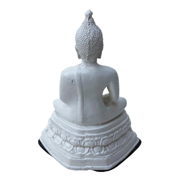 This zen statue will finish any shelf or tabletop with the perfect amount of tranquility. The piece has a few wear marks...