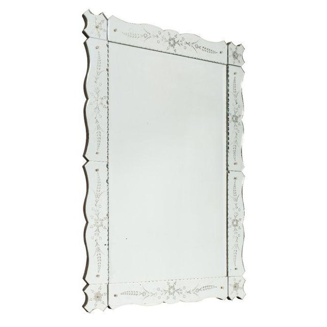 An Art Deco French mirror from the Art Deco period in a rectangular shape. The frame is made of mirror as well, with...