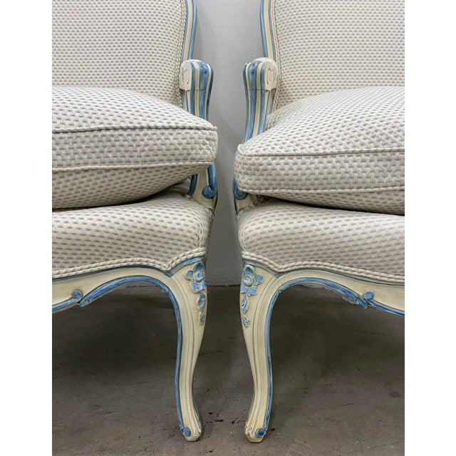 Pair of French Style Carved & Upholstered Arm Chairs c.1940s Gorgeous blue and white down filled upholstery. The chairs...