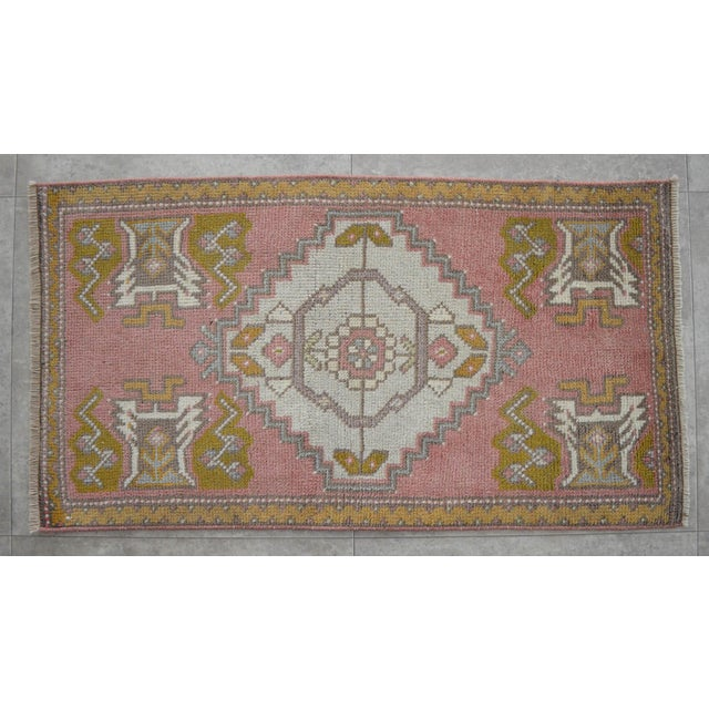 a Vintage Small rug, desaturated red-orange/desaturated vermilion background color yastik rug perfect for a small guest...