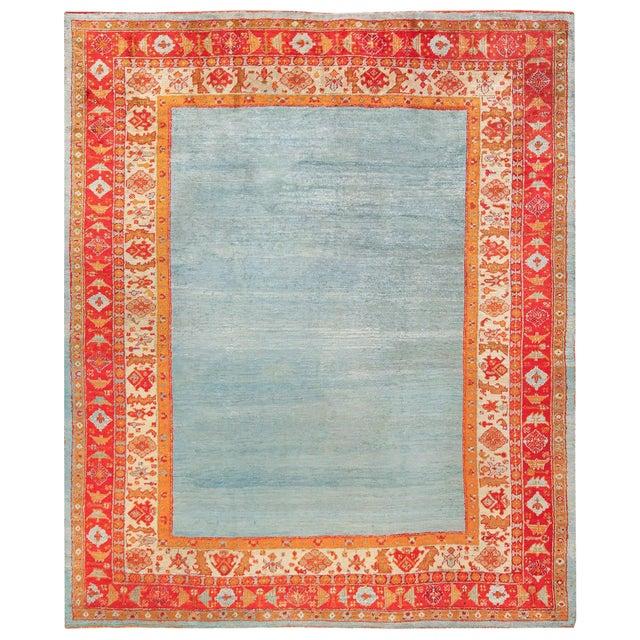 Antique Turkish Angora Oushak Light Blue Open Field Rug - 10′3″ × 12′9″ For Sale