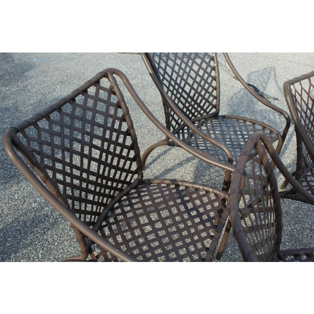 Set of four outdoor Brown Jordan garden chairs made of aluminum with woven vinyl straps. Made in the mid 20th century.
