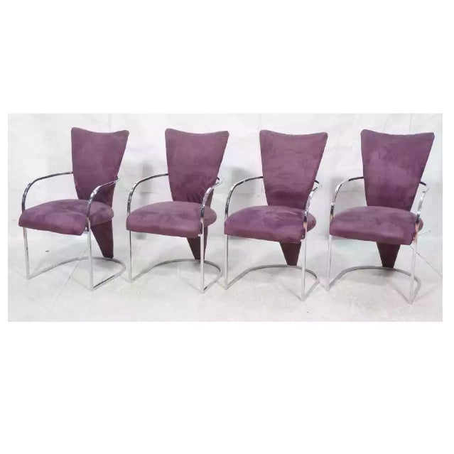 """Super modern set of four plum colored ultra suede armed dining chairs with a curved back. Seat height 18"""" Arm height 25"""""""