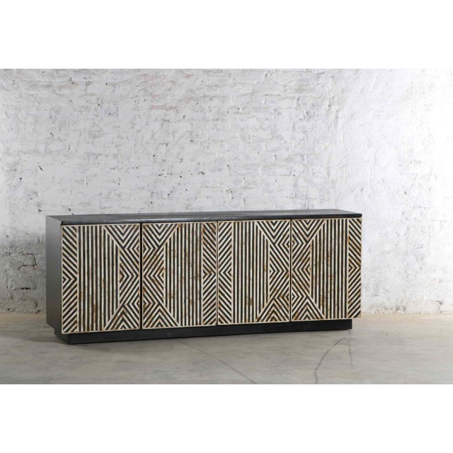 Designed by Erdos + Ko. The Tatum is constructed with solid mango wood. The doors have an unique tribal influenced...