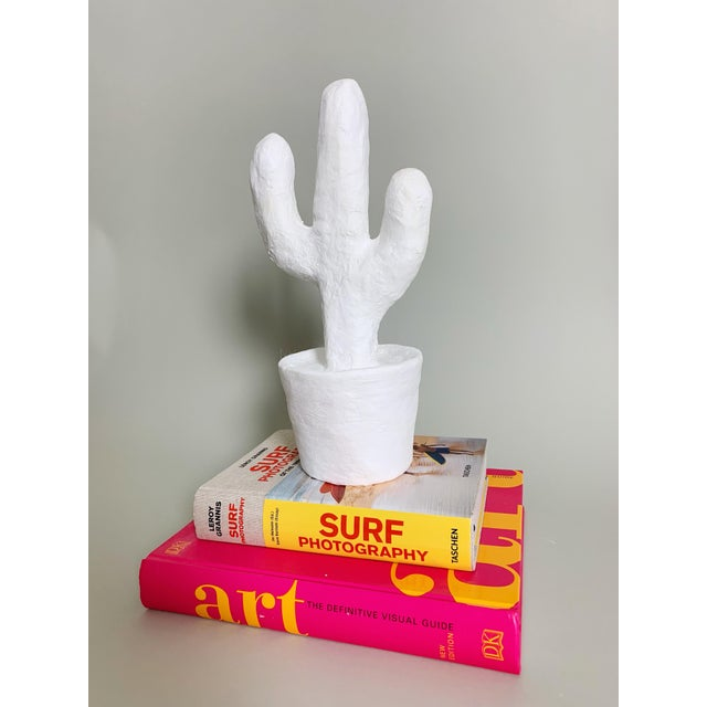 Say hello to the saguaro, the cutest lil cactus accessory in our signature white plaster material...use on a book shelf,...