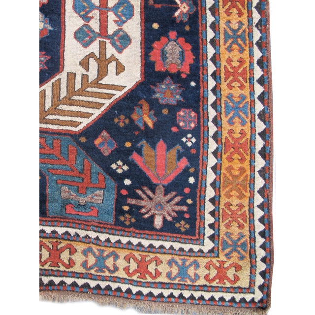 Woven in the historic Karabagh region of the South Caucasus, this dynamic Caucasian carpet proves that the weavers of this...