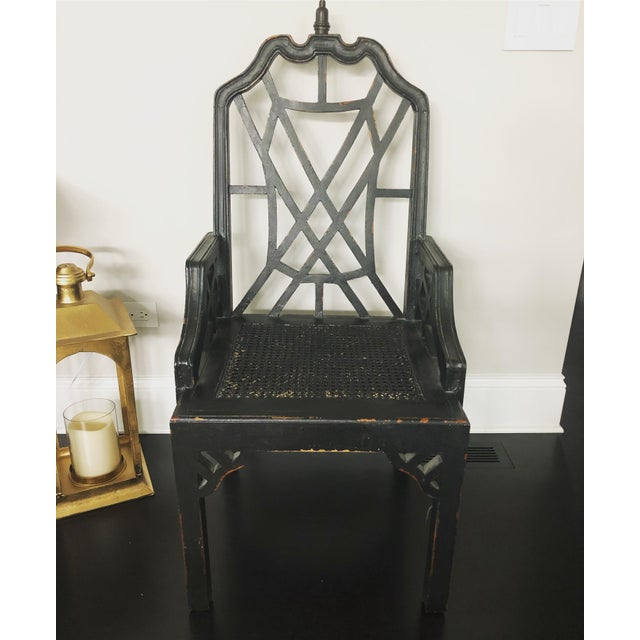 Offered is a solid wood Chinese Chippendale style arm chair. This piece features a black finish with purposeful...
